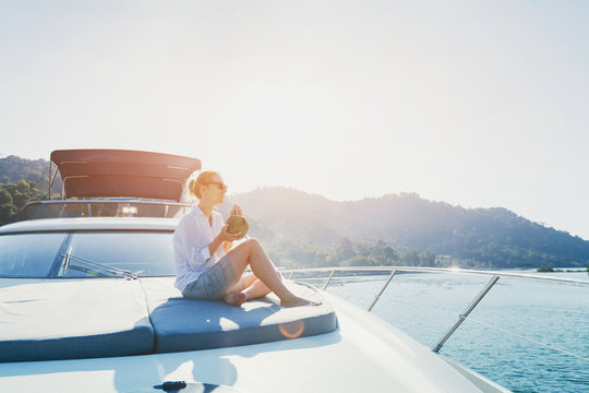 woman enjoying sunset trip onboard of luxuious yacht, luxury sea cruise travel on the boat
