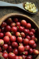 fresh coffee beans in wooden bowl