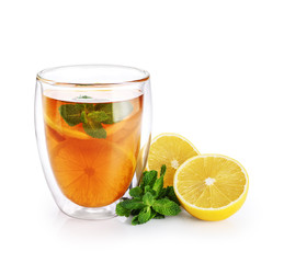 Photo sur Aluminium The Hot tea with mint and lemon in a glass with double walls isolated on white background.