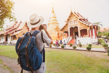 travel to Asia, tourist photographer taking photo of temple or landmark, tourism in Thailand