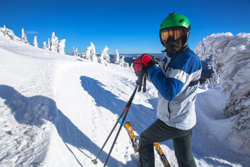 Man skier on a slope in the mountains