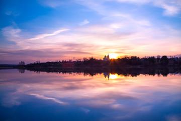 rural landscape with sunrise over river