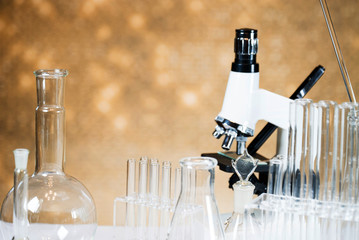 Microscope with lab glassware, science laboratory research concept