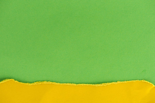 close-up shot of green and yellow paper layers for background