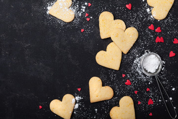 Valentines day background with cookies in shape of heart. Sweet baking. Top view.