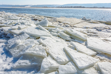 The gathering of ice from the river in early spring