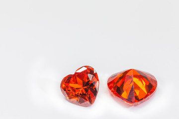 Wall Mural - ruby gemstones in heart shape on white background