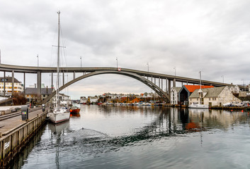 The Bridge to Risoya, sailboats in the canal in the city of Haugesund, Norway
