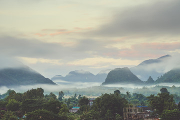 Beautiful sunrise and white mist with mountain at Vang vieng, Laos.