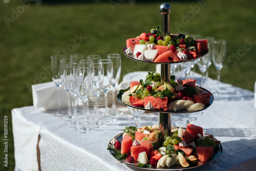 Delicious Fruit Table With Different Sweets For Wedding Reception