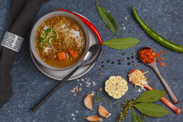 Indian vegetarian lentil soup, mung dal. Indian food spice concept. Dark background, top view. Vegan Healthy Food Concept.