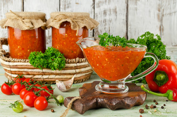 Homemade hot sauce adjika with vegetables