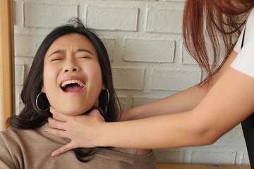 woman screaming, being strangled, concept of crime, robbery, murder, urban danger