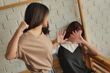 two women fighting, punching, hitting, concept of domestic violence,  physical assault crime Wall mural