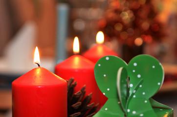 Christmas candle burning at night.