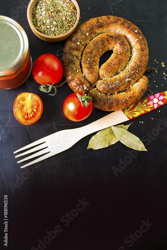homemade sausage and seasoning on the table