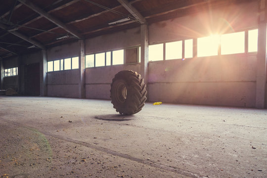 old lorry tire in the empty hangar