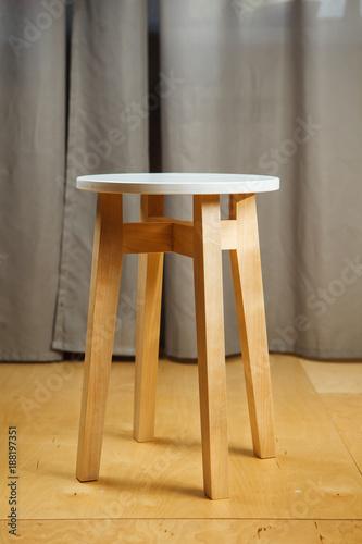Excellent Wooden Stool With Round Seat And Long Legs Stands On Parquet Inzonedesignstudio Interior Chair Design Inzonedesignstudiocom