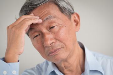 sick stressed old senior man headache, dizzyness, sinus inflammation, stress, migraine, alzheimer, parkinson disease concept