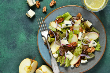 Vegetarian salad with blue cheese, apples and walnuts with mustard sauce.