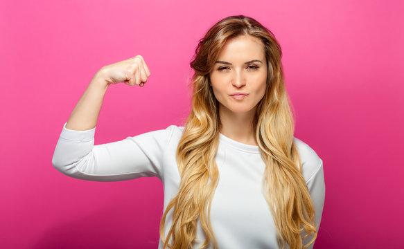 Successful woman raising hand in success gesture
