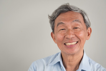happy smiling positive old senior retired man portrait