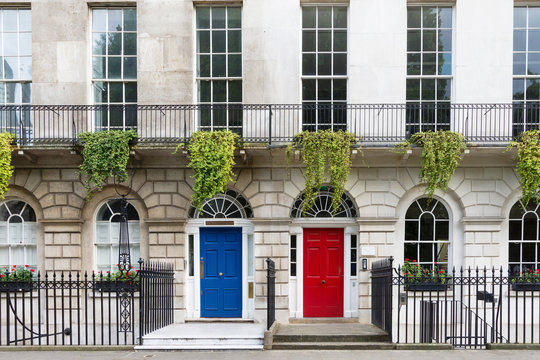Town house with red and blue door, London, UK
