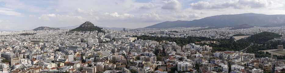 Athens, Greece day view ranging from Mount Lycabettus to Panathenaic Stadium. Panoramic view of Lykavittos hill, The Greek Parliament in the center and to the far right the Temple of Olympian Zeus.