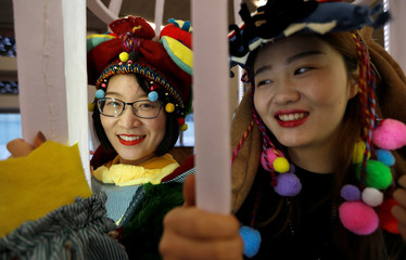 """Student artists Zonqxiu Xie (L) and Yiwei Shi from Central St. Martins college, pose with their work, """"Zootudio"""" at the Tate Exchange programme at Tate Modern in London"""