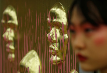 """Student artist Reggy Liu from Central St. Martins college, shows off her work, """"Perfect and the Imperfect"""" at the Tate Exchange programme at Tate Modern in London"""