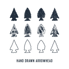 Hand drawn textured arrowheads vector illustrations set.