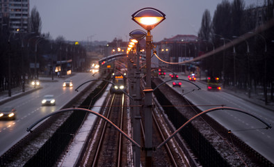 Tram line in the city in the evening. Selective focus.