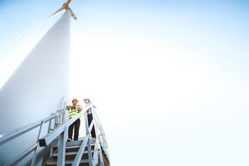 Male engineer and female engineer Working at turbine.