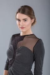 Portrait of business woman wearing gray dress.