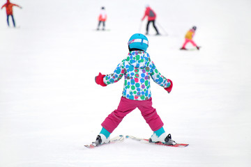 little girl in the winter resort