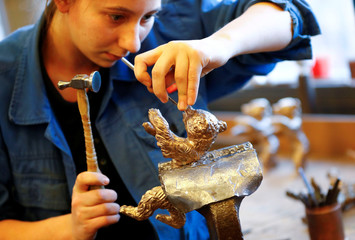 Charlotte Nowacki works on a cast of a Berlin Bear award for the upcoming Berlinale International Film Festival at the Noack foundry in Berlin