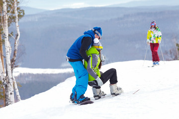 snowboarders on  ski resort