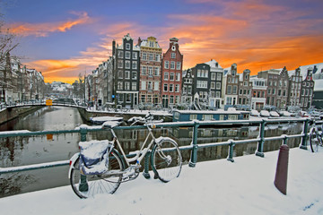 Cityscenic from Amsterdam in winter in the Netherlands at sunset