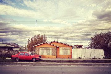 Retro stylized picture of an empty street of Puerto Natales, Chile.