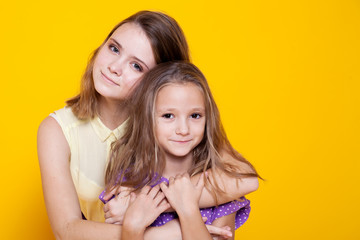 Portrait of two girls love sisters