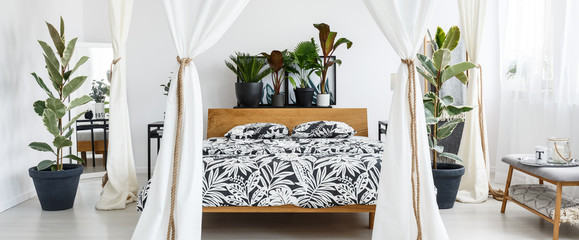 White marquees in floral bedroom