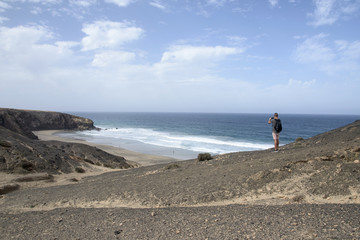 young man taking a picture in Fuerteventura, Spain
