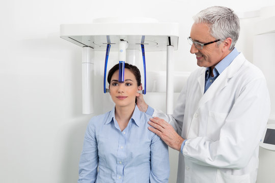 A dentist with his patient doing an x-ray panoramic digital