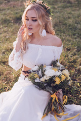 Bride. Boho bride with wreath on sunset outdoor. Boho style. Series