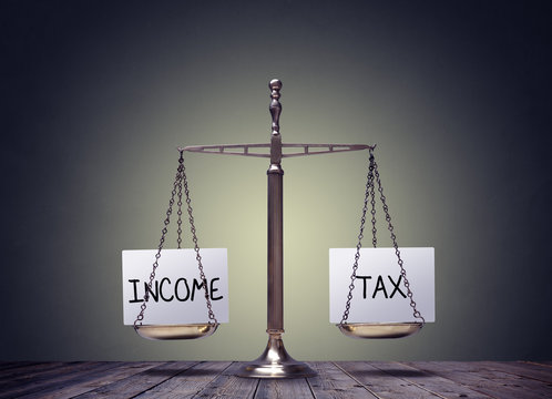 Income tax balancing finance books scales concept