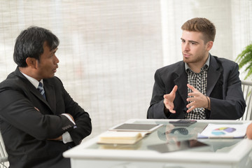 Young professionals work in modern office.Project manager team discussing new idea