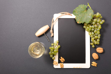 blackboard with grapes and wine