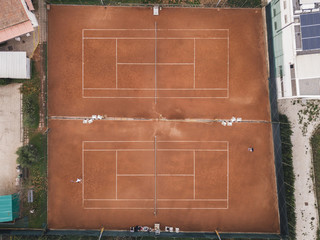 Aerial view of tennis match on clay court