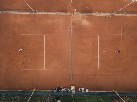 Aerial photo of a tennis match on clay court