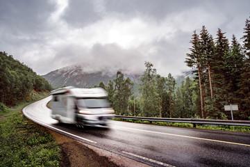 VR Caravan car travels on the highway.